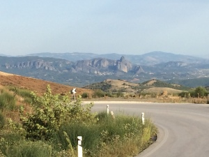 Rounding a corner and seeing the prize at the end of the day--the Meteora cliffs.