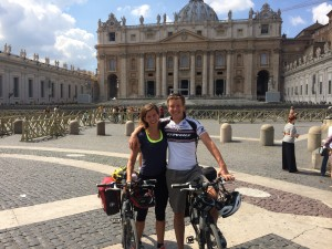 A couple just arriving at the Vatican from Berlin on their bicycles.