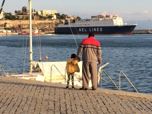Father and daughter on the Aegean Sea in Kavala, Greece