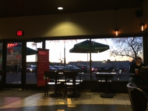 Watching the rhythm of life from my perch in Starbucks