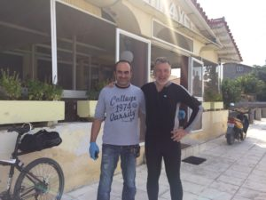 Standing with shop owner after sharing thick chewy Greek coffee while he was preparing for a funeral!
