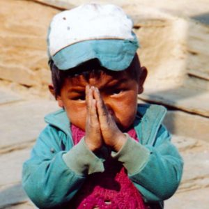 A child using the Namaste greeting